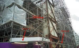 Before building wrap showing scaffolding